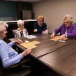 Elderly Friends Playing Bingo