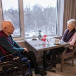 Elderly couple by the window