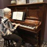 elderly Women playing the piano